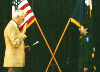 Lt Col Robert Cox, USAF (Ret) administers the oath of office for Peggy.